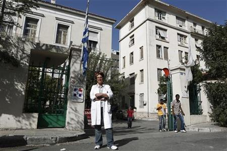 Greek doctor Eleni Kakalou poses at an entrance of Evangelismos General Hospital in Athens October 16, 2012. REUTERS/Yorgos Karahalis