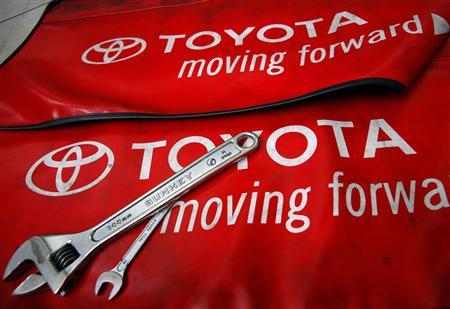 Toyota pushes up profit forecast, details China hit