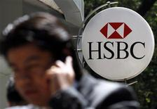 A man talking on a mobile phone walks past a HSBC branch office in Mexico City, in this file picture taken July 27, 2012. REUTERS/Edgard Garrido/Files