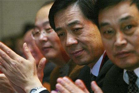 Bo Xilai (2nd R), then Governor of Liaoning Province, pauses at the China Entrepreneur Annual Meeting 2003 in Beijing in this December 7, 2003 file photo. REUTERS/Jason Lee/Files