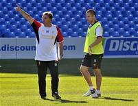 Liverpool FC's manager Brendan Rodgers (L) gestures beside player Joe Cole during his team's practice for their upcoming World Football Challenge soccer match against Toronto FC in Toronto July 20, 2012. REUTERS/ Mike Cassese