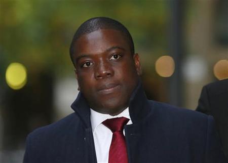 Former UBS trader Kweku Adoboli arrives at Southwark Crown Court in London October 25, 2012. REUTERS/Olivia Harris