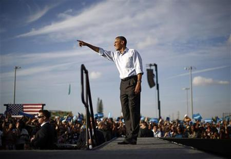 U.S. President Barack Obama points to the crowd during an election campaign rally at McArthur High School in Hollywood, Florida November 4, 2012. REUTERS/Jason Reed (UNITED STATES - Tags: POLITICS USA PRESIDENTIAL ELECTION ELECTIONS)