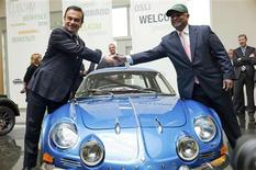 Carlos Ghosn (L), Chairman and CEO of the Renault-Nissan Alliance, and AirAsia Group CEO and Caterham Group Chairman Tony Fernandes shake hands over an Alpine sports car after a press conference in Boulogne-Billancourt, near Paris, November 5, 2012. REUTERS/Julien Muguet