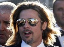 """Cast member Brad Pitt poses on the red carpet ahead of the screening of the film """"Killing Them Softly"""", in competition at the 65th Cannes Film Festival, May 22, 2012. REUTERS/Jean-Paul Pelissier"""