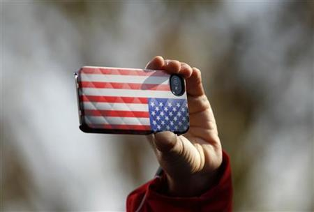 An Obama supporter records the moment as U.S. Vice President Joe Biden speaks during a campaign rally in Sterling, Virginia November 5, 2012. REUTERS/Kevin Lamarque