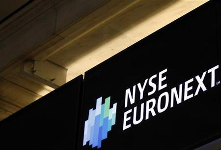 A NYSE Euronext sign is seen over the the floor of the New York Stock Exchange, May 14, 2012. REUTERS/Brendan McDermid (UNITED STATES - Tags: BUSINESS)