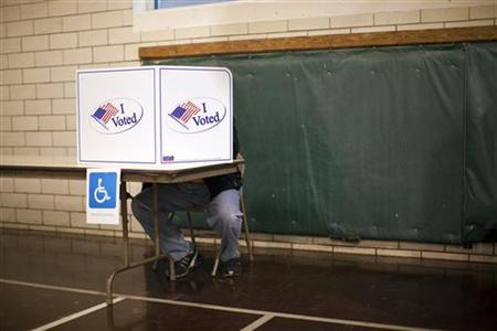 People vote at Holy Cross School during the U.S. presidential election in Indianapolis, Indiana, November 6, 2012. REUTERS/Aaron Bernstein