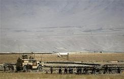 U.S. troops arrive near the site of an incident Kabul August 2, 2012. Afghan security forces killed five insurgents and wounded one during a pre-dawn raid in Kabul on Thursday, with authorities saying they had thwarted a mass attack and captured intelligence pointing to the militant Haqqani network. REUTERS/Omar Sobhani