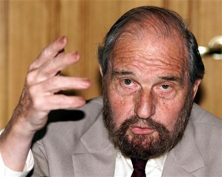 Soviet secret agent George Blake gestures as he speaks at a presentation of a book of letters written by other spies from a British prison, in Moscow in this file June 28, 2001 photo. REUTERS/Alexander Natruskin
