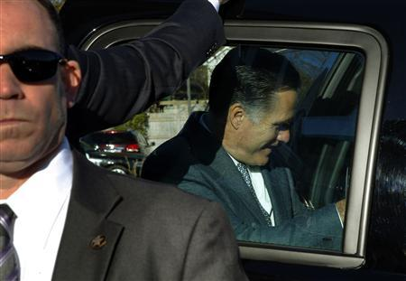 Republican presidential nominee Mitt Romney gets into his vehicle after voting in Belmont, Massachusetts November 6, 2012. REUTERS/Brian Snyder