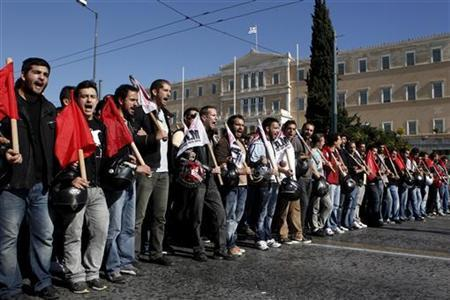 Protesters shout slogans during an anti-austerity rally in front of the parliament in Athens November 6, 2012. REUTERS/Yorgos Karahalis