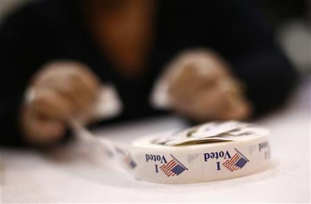 A poll worker prepares 'I Voted' stickers at Harrison United Methodist Church during the U.S. presidential election in Pineville, North Carolina November 6, 2012. REUTERS/Chris Keane