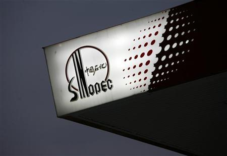 The Sinopec logo is seen at one of its gas stations in Hong Kong April 26, 2010. REUTERS/Bobby Yip