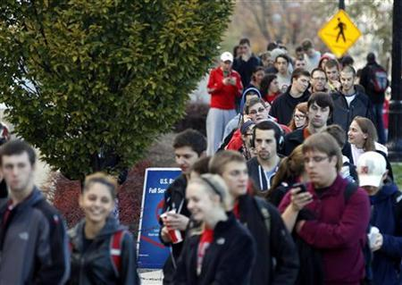 Voters wait in line at the Ohio Union to cast their ballots during the U.S. presidential election at The Ohio State University in Columbus, Ohio November 6, 2012. REUTERS/Matt Sullivan