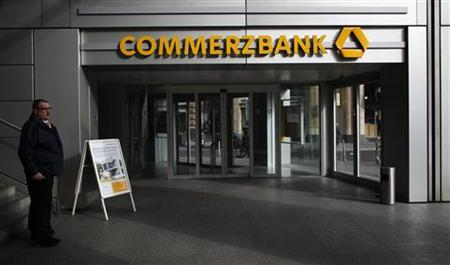 A man stands beside the entrance of the German Commerzbank headquarters in Frankfurt October 29, 2012. REUTERS/Lisi Niesner (GERMANY - Tags: BUSINESS)