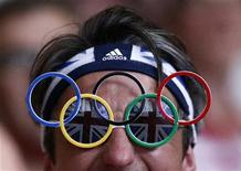 Spectator wears glasses with the shape of the Olympic logo attending the men's 94Kg group B weightlifting competition at the ExCel venue at the London 2012 Olympic Games August 4, 2012. REUTERS/Dominic Ebenbichler