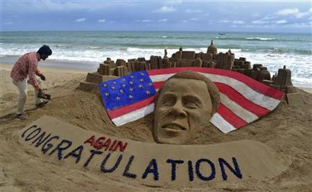 Indian sand artist Sudarshan Patnaik gives final touches to a sand sculpture of U.S. President Barack Obama on a beach at Puri, in the eastern Indian state of Odisha November 7, 2012. REUTERS/Stringer