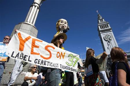 A demonstrator holds a sign during a rally in support of the state's upcoming Proposition 37 ballot measure outside the Ferry Building in San Francisco, California October 6, 2012. REUTERS/Stephen Lam