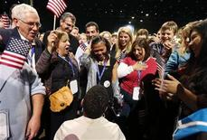Keesha Patterson of Ft. Washington, Maryland (bottom) proposes marriage to her girlfriend Rowan Ha (C) during the election night victory rally at re-elected President Barack Obama headquarters in Chicago, November 6, 2012. REUTERS/Kevin Lamarque