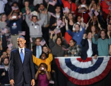 Supporters cheer as U.S. President Barack Obama smiles after giving his acceptance speech during his election night victory rally in Chicago, November 7, 2012. REUTERS/Philip Andrews