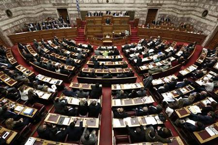 Greece's Prime Minister Antonis Samaras addresses parliamentarians during a session in Athens November 7, 2012. REUTERS/Yorgos Karahalis