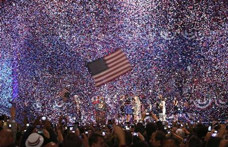 Confetti obscures the stage as U.S. President Barack Obama celebrates after winning the U.S. presidential election in Chicago, Illinois, November 7, 2012. REUTERS/Philip Scottr- Andrews