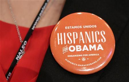 A woman wears a pin which says ''Hispanics for Obama'' before U.S. President Barack Obama spoke at the National Association of Latino Elected and Appointed Officials (NALEO) annual conference in Lake Buena Vista, Florida June 22, 2012. REUTERS/Kevin Lamarque