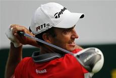 Edoardo Molinari of Italy watches his shot on the first hole during the BMW Masters 2012 golf tournament at Lake Malaren Golf Club in Shanghai, October 26, 2012. REUTERS/Carlos Barria