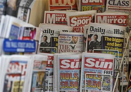 British newspapers are displayed at a newsagent's stand in central London January 22, 2011. REUTERS/Luke MacGregor