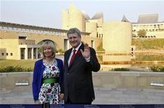 Canadian Prime Minister Stephen Harper (R) waves to the photographers as his wife Laureen watches at the Virasat-e-Khalsa (Khalsa heritage memorial complex) at Anandpur Sahib in the northern Indian state of Punjab November 7, 2012. REUTERS/Ajay Verma