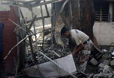 A paramilitary soldier collects evidence at the site of a blast near the Ranger's office in Karachi November 8, 2012. REUTERS/Athar Hussain