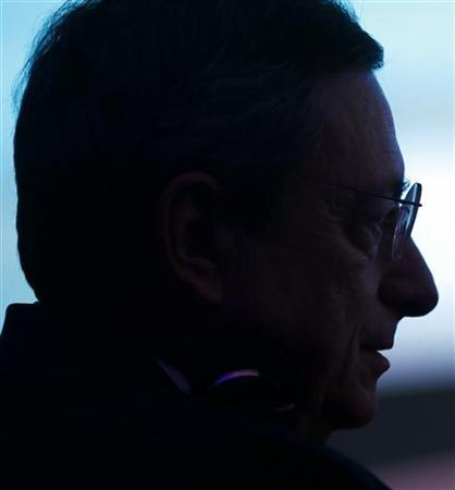 European Central Bank President Mario Draghi is silhouetted as he attends the Economy Day 2012 in Frankfurt November 7, 2012. REUTERS/Ralph Orlowski (GERMANY - Tags: BUSINESS HEADSHOT)