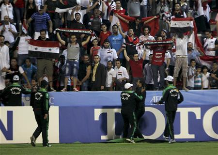 Assad fans vent over Syria at Qatar soccer match