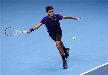 Switzerland's Roger Federer returns a shot during his men's singles tennis match against Spain's David Ferrer at the World Tour Finals in the O2 Arena in London November 8, 2012. REUTERS/Kieran Doherty