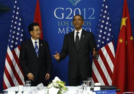 11月8日、オバマ米大統領が再選を果たし、中国共産党が間もなく新指導部になる今、米中両国がわだかまりを捨てられると期待する理由は十分ある。写真はG20サミットでのオバマ大統領と胡錦涛国家主席。メキシコ・ロスカボスで6月撮影(2012年 ロイター/Jason Reed)