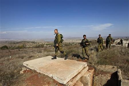 Israeli soldiers walk near Alonei Habashan close to the Israeli-Syrian border in the Golan Heights November 4, 2012. REUTERS/Nir Elias