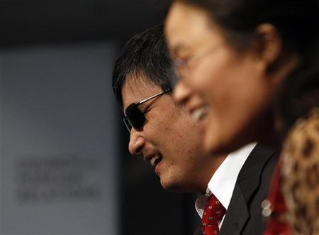 Activist and advocate Chen Guangcheng and his wife Yuan Weijing (R) smile at the Council on Foreign Relations in New York May 31, 2012. REUTERS/Eric Thayer