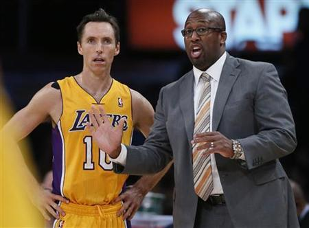Los Angeles Lakers coach Mike Brown (R) chats to Steve Nash of Canada during their loss to the Dallas Mavericks in their NBA basketball game in Los Angeles, October 30, 2012. REUTERS/Lucy Nicholson