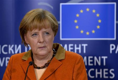 Germany's Chancellor Angela Merkel holds a news conference after addressing the political groups at the European Parliament in Brussels November 7, 2012. REUTERS/Eric Vidal