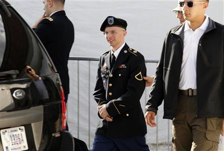 Army Private First Class Bradley Manning (C) is escorted in handcuffs as he leaves the courthouse in Fort Meade, Maryland in this June 6, 2012, file photo. REUTERS/Jose Luis Magana/Files