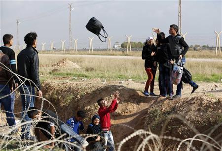 Fleeing fallen Syrian town, refugees fear Assad's...