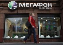 A man walks past a MegaFon retail outlet along a street in Moscow September 4, 2012. REUTERS/Maxim Shemetov