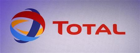 The logo of French oil company Total is seen during the company's 2011 annual result presentation in Paris February 10, 2012. REUTERS/Jacky Naegelen