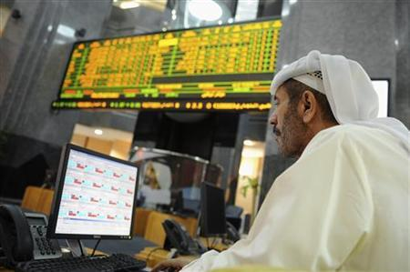 An investor monitors a stock exchange information screen at the ADX Abu Dhabi Securities Exchange stock market October 23, 2012. Private equity firms in the Middle East are preparing to exit a range of investments, a sign that asset markets in the region are recovering from the twin blows of Arab Spring uprisings and the global financial crisis. Picture taken October 23, 2012. To match MIDEAST-PRIVATEEQUITY REUTERS/Ben Job (UNITED ARAB EMIRATES - Tags: BUSINESS)