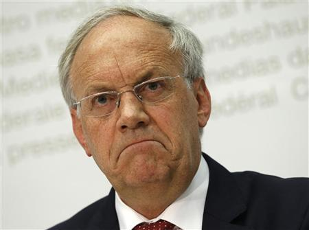Swiss Economy Minister Johann Schneider-Ammann looks on during a news conference on the upcoming popular vote on the new animal disease law in Bern October 22, 2012. REUTERS/Ruben Sprich