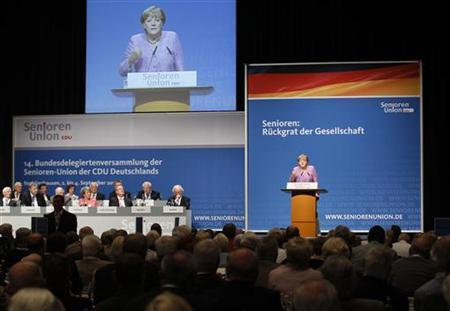 German Chancellor Angela Merkel makes a speech during a senior delegates meeting of the conservative Christian Democratic Union (CDU) in the western city of Recklinghausen, September 3, 2012. German Labour Minister Ursula von der Leyen said today's low income earners may face poverty upon retiring. REUTERS/Ina Fassbender (GERMANY - Tags: POLITICS)