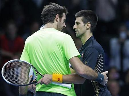 Argentina's Juan Martin Del Potro (L) and Serbia's Novak Djokovic embrace after their men's singles semifinal tennis match at the ATP World Tour Finals at the O2 Arena in London November 11, 2012. REUTERS/Suzanne Plunkett