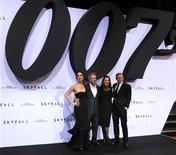 Actress Berenice Marlohe, director Sam Mendes, producer Barbara Broccoli and actor Daniel Craig (L-R) pose on the red carpet as they arrive for the German premiere for the film 'Skyfall' in Berlin October 30, 2012. REUTERS/Tobias Schwarz