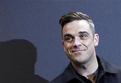 Robbie Williams takes UK pop charts' crown